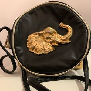 Vintage 80s leather back with Gold hardware
